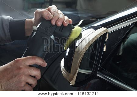 Car Service. Polishing Mirror Of The Car