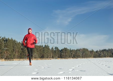 Man running outdoors in winter snowy day