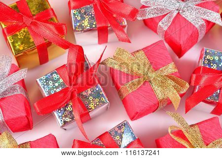 Top View Of Colorful Gifts Close-up On A White