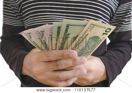 Hand holding cash, selective focus on hand isolated on white background