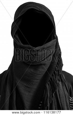 Faceless man under black veils isolated on white background