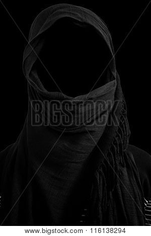 Faceless man under black veils isolated on black background
