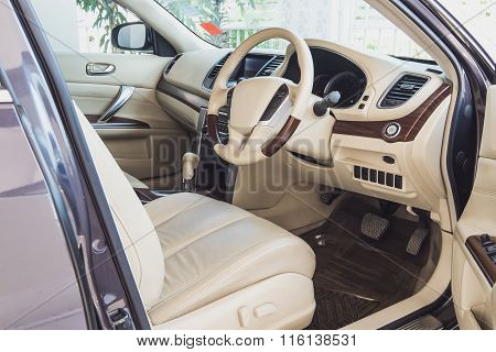 Old luxury modern car interior, beige color