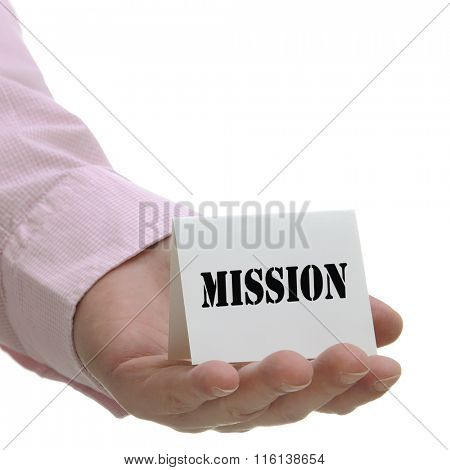Business man holding mission sign on hand