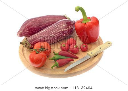 Vegetables on wooden board isolated