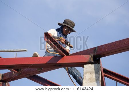 Worker Welding The Steel To Build The Roof