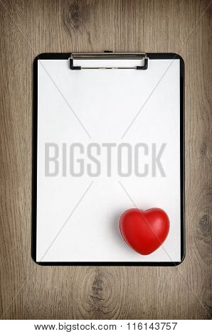 Clipboard With Blank White Paper And Heart Shape