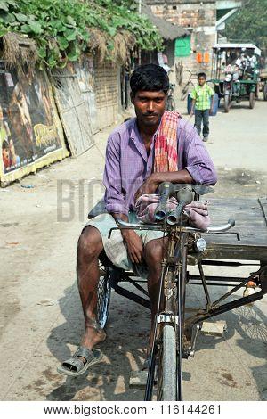 BARUIPUR, INDIA - JANUARY 14: Rickshaw driver waits for the next customer on January 14, 2009 in Baruipur, West Bengal, India.