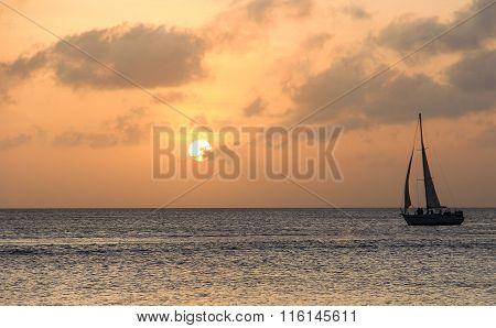 Ocean Sailboat At Sunset