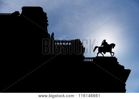 Silhouette Of Man On Horse Statue On Top Of A Vienna's Building