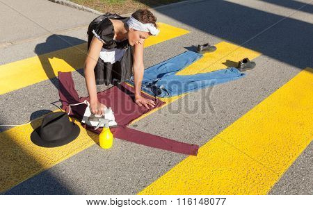 portrait of a housewife who irons in the road