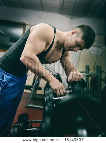 Healthy Man Exercising with Arm Weights