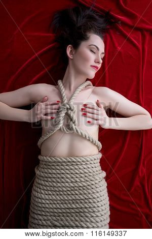 Kinbaku. Beautiful young model tied with rope