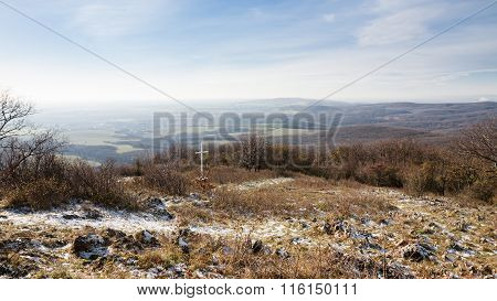 Cross On Hill Above Rural Countryside
