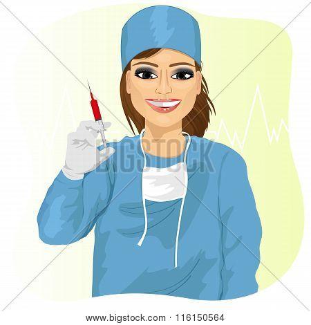 Female doctor holding a syringe