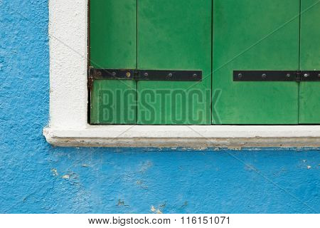 green shutter, blue house