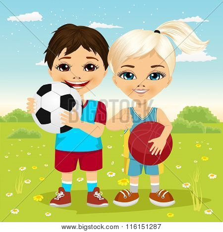 little girl and boy holding a soccer ball and basketball