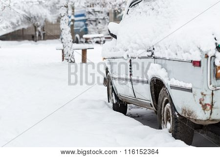 Car Covered With Snow After Snowstorm.