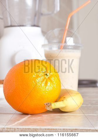 Orange And Banana With Smoothie And Blender