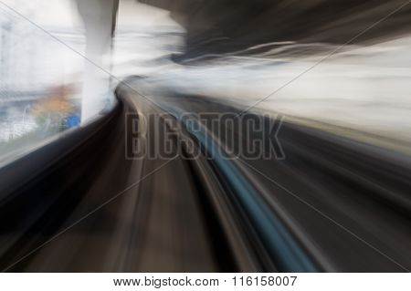 Moving motion blurred of Monorail travel into tunnel