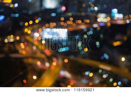 Blurred bokeh light city highway intersection