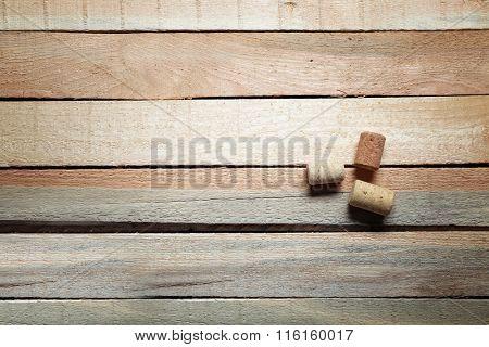 Three wine corks on wooden background
