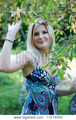 Beautiful fresh spring girl outdoors in a garden