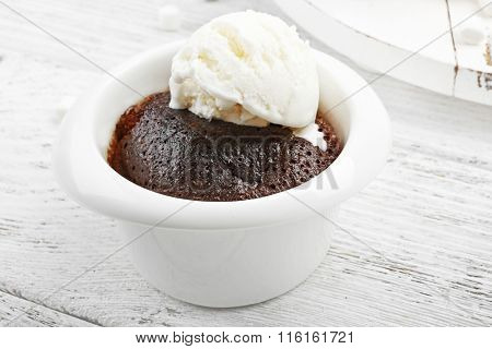 Chocolate lava cake with ice-cream in a bowl, close-up