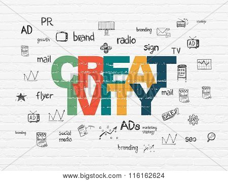 Advertising concept: Creativity on wall background