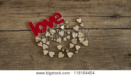 Small wooden hearts on old wooden background. Valentines day ideas.