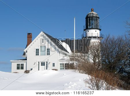 Old Lighthouse Buried In Snow