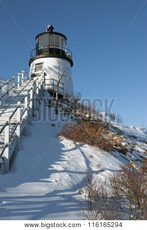 Owls Head Lighthouse On Snow Covered Cliff