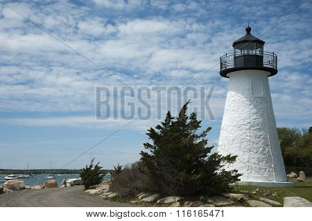 White Lighthouse Overlooks Harbor