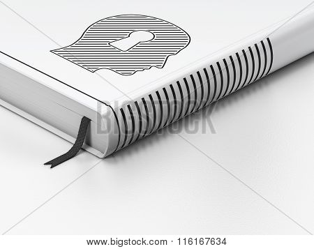 Learning concept: closed book, Head With Keyhole on white background