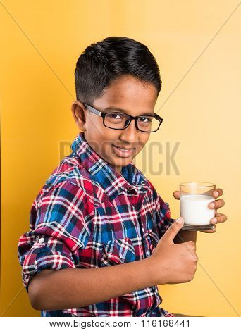 indian boy with a glass of milk, indian kid drinking milk, indian boy drinking milk,asian boy and mi