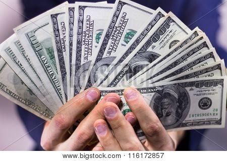 Fan of hundred-dollar bills