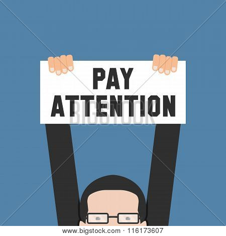 Hand Holding Banner With Pay Attention