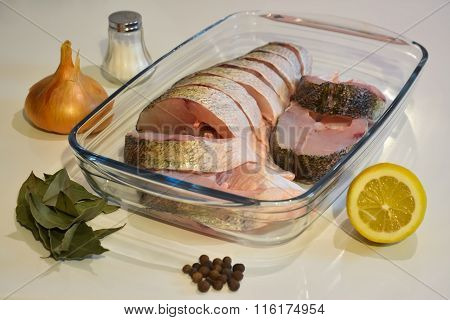 Sliced Fish In A Glass Tray, Salt And Spices