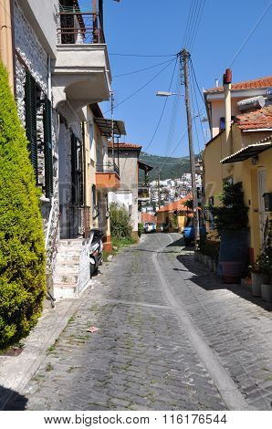 Cottages on a paved road, Kavala, Greece
