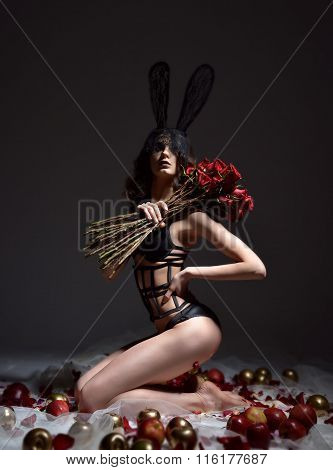 Fashion Sexy Brunette Woman In Sensual Vintage Rabbit Mask With Bouquet Of Red Roses