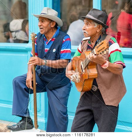 HAVANA,CUBA - JANUARY 26,2016 : Senior musicians playing traditional cuban music on a street in Old Havana