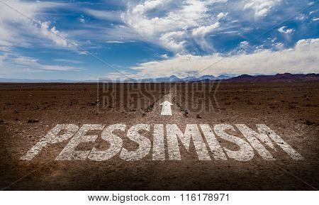 Pessimism written on desert road