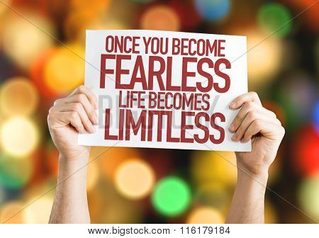 Once You Become Fearless Life Becomes Limitless placard with bokeh background