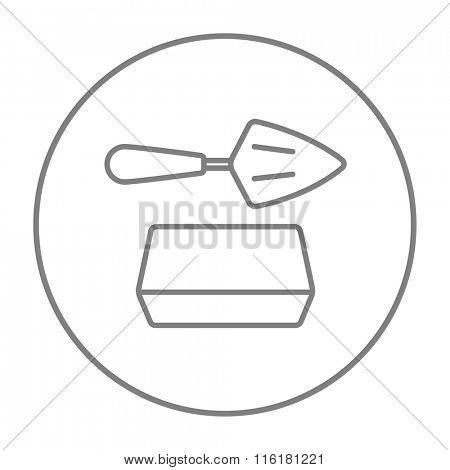 Spatula with brick line icon.