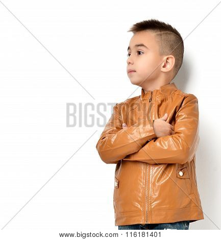 Fashion Beautiful Little Boy In Yellow Winter Brown Leather Clothing Jacket Standing