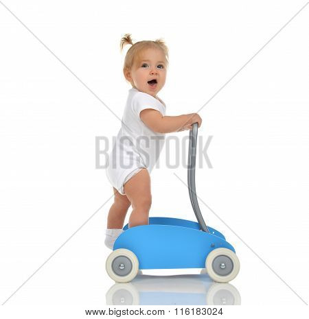 Cute Smiling Baby Girl Toddler With Toy Walker Make First Steps