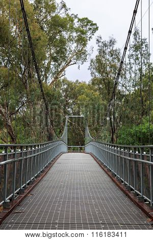 Steel Suspension Footbridge Over River