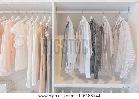 Dress And Shirts Hanging On Rail