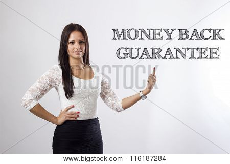 Money Back Guarantee - Beautiful Businesswoman Pointing