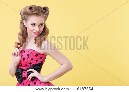Attractive young woman is evincing her sexuality